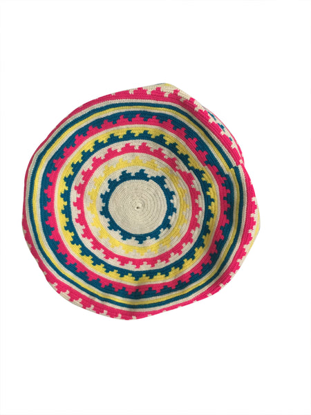 Image of bottom of una hebra Wayuu mochila purse, drawstring crossbody bag with tassels - base color white with yellow, blue and bright pink small wave design