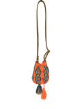 Image of Wayuu mini mochila bucket bag purse with adjustable light brown leather strap, drawstring and two tassels; bag is bright orange base with bright blue, yellow and green geo design