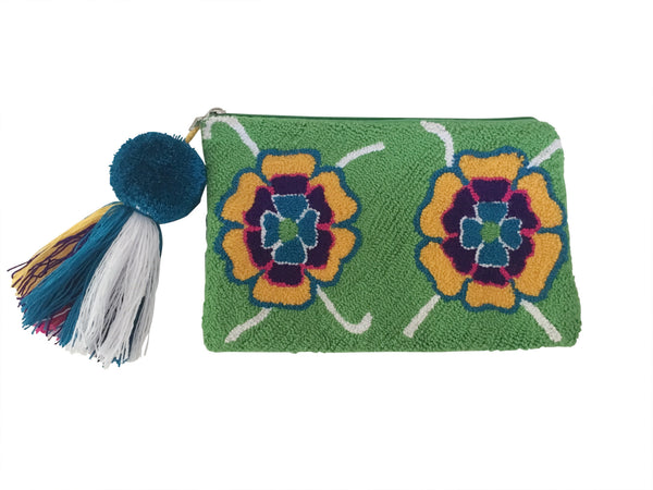 Image of Wayuu tapizado small clutch purse with pom pom tassel; rectangular shape with bright green base and two colorful flowers on each side