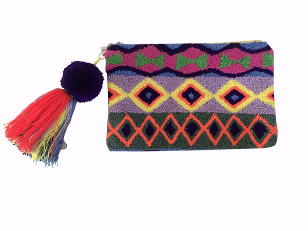 Image of Wayuu tapizado small clutch purse with removable pom pom tassel; rectangular shape with bright colors and triangle design