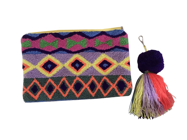 Image of Wayuu tapizado small clutch purse with removeable pom pom tassel; rectangular shape with bright colors and triangle designs