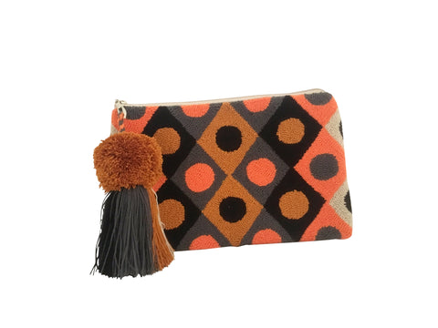 Image of Wayuu clutch purse, rectangular shape with pompom tassel and zipper - clutch has diamond designs with circles inside, colored orange, burnt orange, grey and black