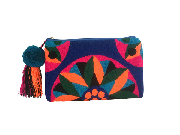 Image of Wayuu clutch purse, rectangular shape with pompom tassel and zipper - clutch has royal blue base with bright orange, jungle green, magenta and teal colorful design