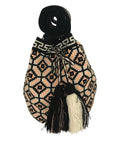 Image of una hebra Wayuu mochila purse, drawstring crossbody bag with tassels - base color black with pink peach, white and purple grey design