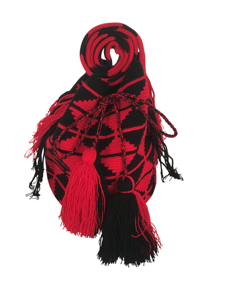 Image of dos hebra Wayuu mochila purse, drawstring crossbody bag with tassels - bag is red base with black triangle design