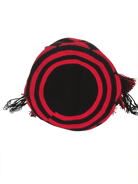 Image of bottom of dos hebra Wayuu mochila purse, drawstring crossbody bag with tassels - bag is red base with black triangle design