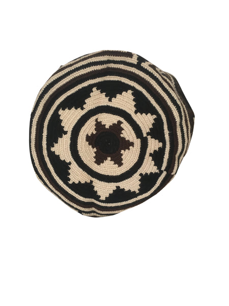 Image of bottom of dos hebra Wayuu mochila purse, drawstring crossbody bag with tassels - bag is black base with dark brown and tan geo design