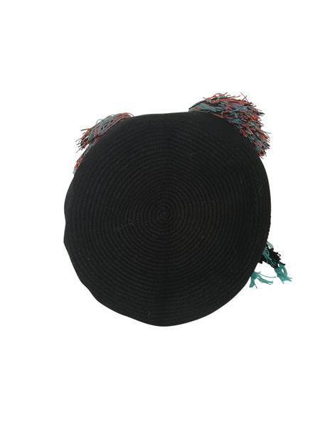Image of bottom of dos hebra Wayuu mochila purse, drawstring crossbody bag with tassels - bag is black with colorful strap and tassels