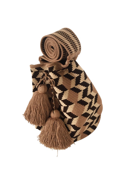Side angle image of Wayuu mochila purse, drawstring crossbody bag with tassels and cloth strap; tan base with light brown, chocolate brown design