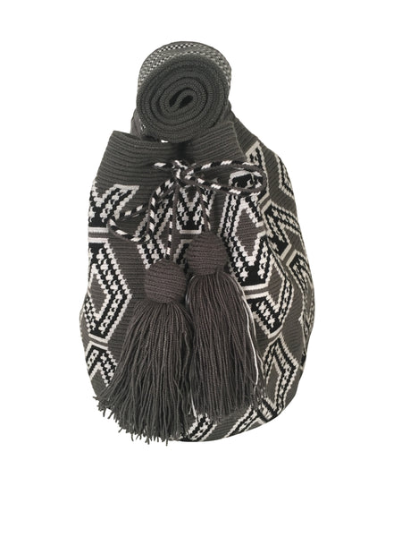 Image of una hebra Wayuu mochila purse, drawstring crossbody bag with tassels - bag is grey base with white and black geometric design