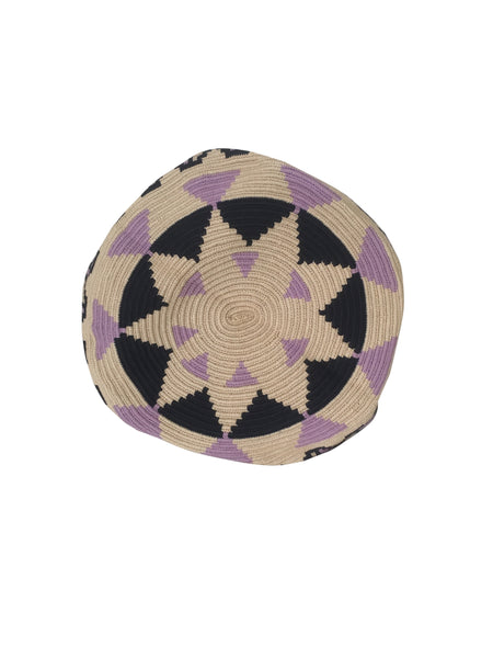 Image of bottom of una hebra Wayuu mochila purse, drawstring crossbody bag with tassels - bag is light tan base with purple and dark purple design