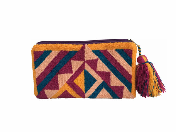 Close up image of Wayuu small clutch purse with tassel; rectangular shape colored yellow, purple, light pink, magenta