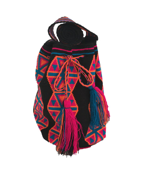 Close up image of Wayuu mochila purse, drawstring crossbody bag with tassels - base color black with pink, orange and blue design