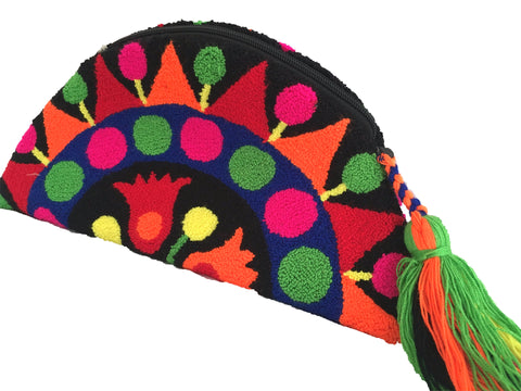 Close up image of Wayuu small clutch purse, semi circle shape with tassel and zipper - black base with multi color design