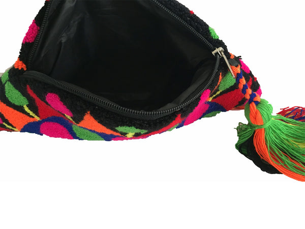 Inside view of lining - Close up image of Wayuu small clutch purse, semi circle shape with tassel and zipper - black base with multi color design