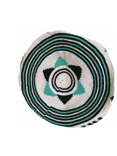 Image of bottom of Wayuu mochila purse, drawstring crossbody bag with tassels and cloth strap; white base with black and teal design