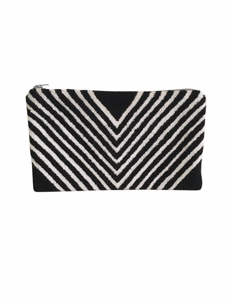 Close up image of Wayuu small clutch purse; rectangular shape black and white striped in a V shape