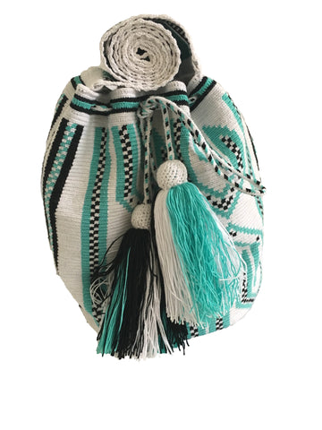 Close up image of Wayuu mochila purse, drawstring crossbody bag with tassels and cloth strap; white base with black and teal design