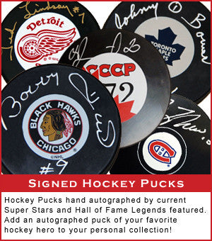 Signed Hockey Pucks