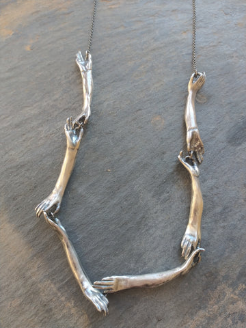 Long Silver Connecting Hands Necklace