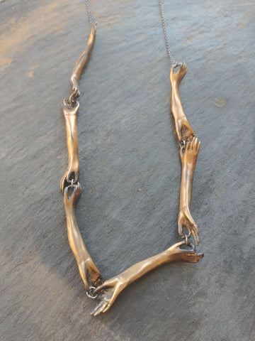Long Bronze Hands Connecting Necklace