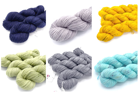 A grid of 6 colors of yarn on a white background - navy blue, light gray, gold yellow, light olive green, dark gray, aqua blue