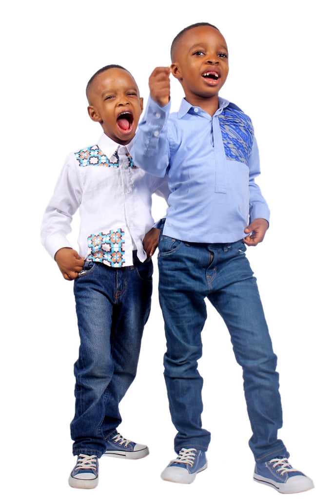 Boys Long Sleeves Shirts White enhanced with a fusion of African Print  A blend of white cotton with a blue flowery patterned Ankara African print to help bring a regular white shirt to live.  Thinking white shirts for boys are always boring? Think again!!!  #DareToStandOut