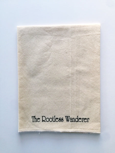 "The Rootless Wanderer | ""My dog winks"" Tea Towel"