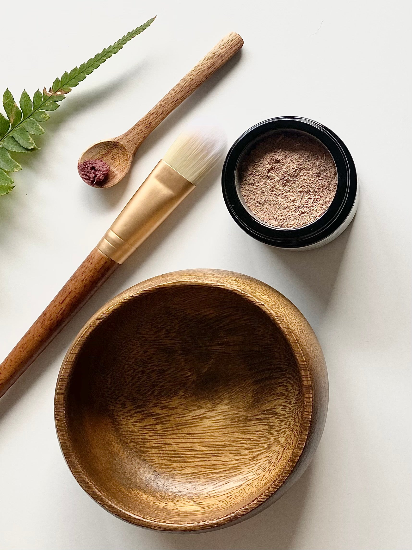 a mask kit with teak wood bowl, spoon and brush