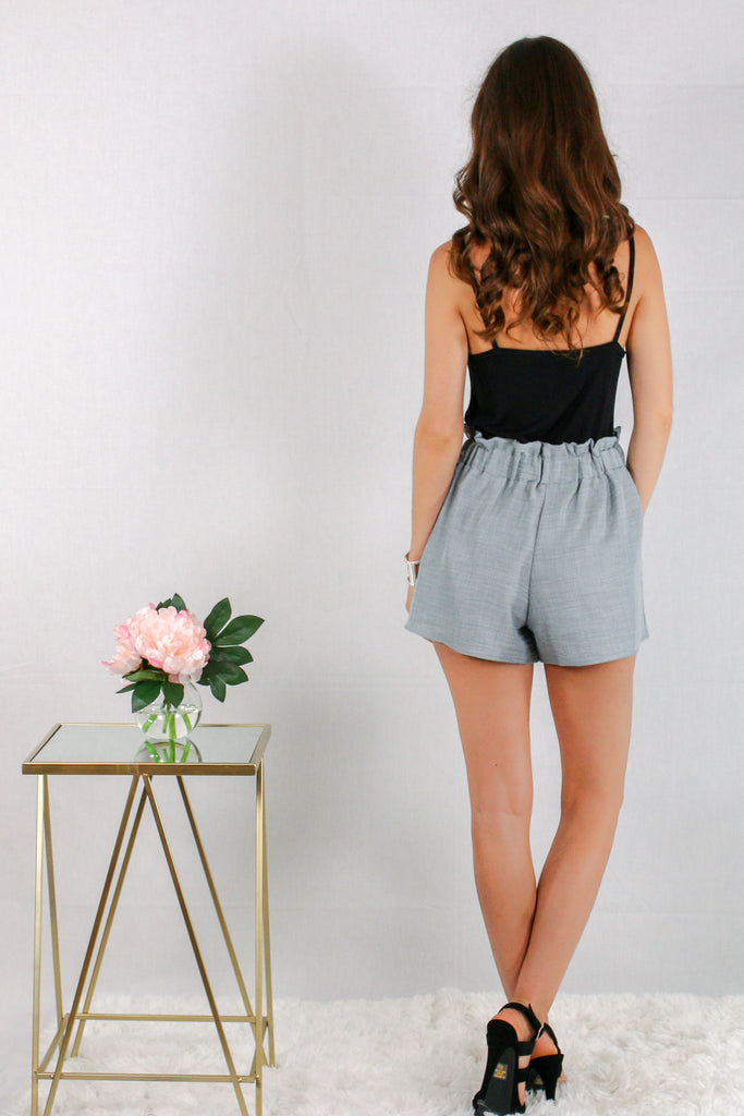 Gray Woven Shorts with Gathered Ruffle Waist and Tie with Black Cami Back View