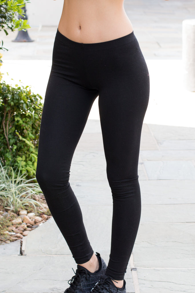 Model wearing women's T Party Black Basic Low-Rise Leggings.