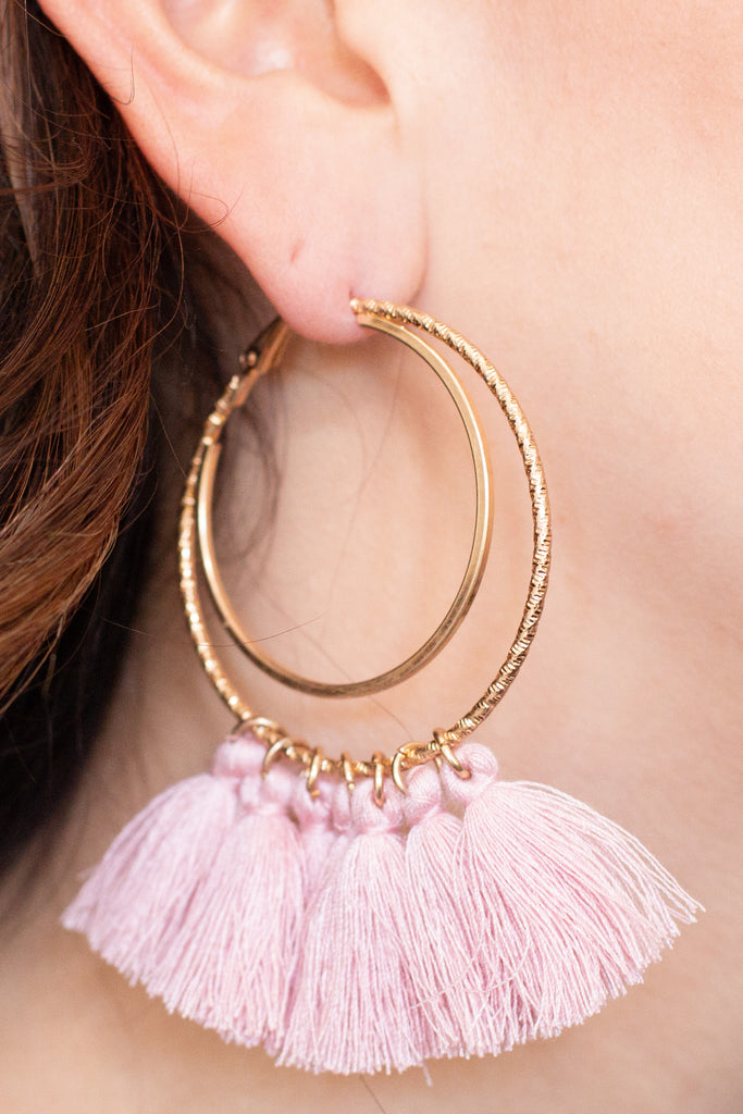 Caroline Hill Gold Double Hoop Earrings with Pink Tassels closeup
