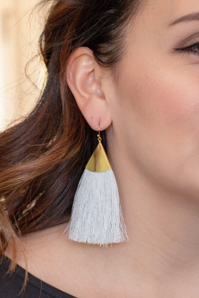 Caroline Hill grey and gold drop tassel earrings.