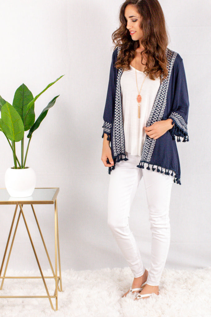 Navy Kimono Style Cardigan with White Embroidered Neck/Sleeves and Pom Trim Front View