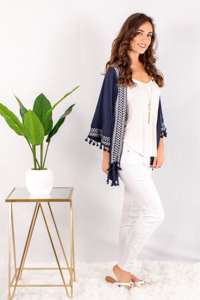 Navy Kimono Style Cardigan with White Embroidered Neck/Sleeves and Pom Trim Side Right View