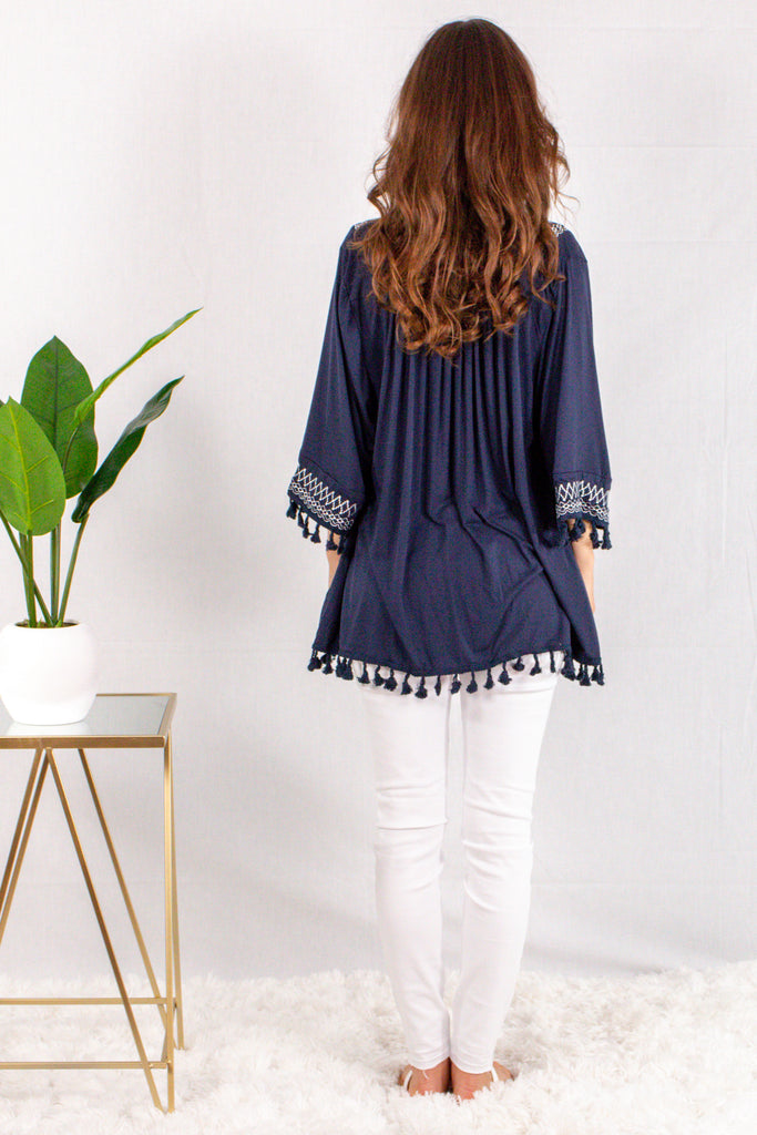 Navy Kimono Style Cardigan with White Embroidered Neck/Sleeves and Pom Trim Back View