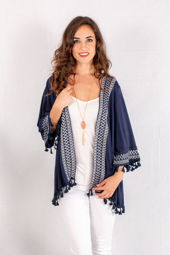 Navy Kimono Style Cardigan with White Embroidered Neck/Sleeves and Pom Trim Close Up