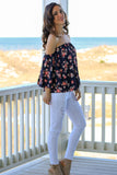 Navy with Floral Print Off the Shoulder 3/4 Sleeve Top and White Skinny Jeans Side View