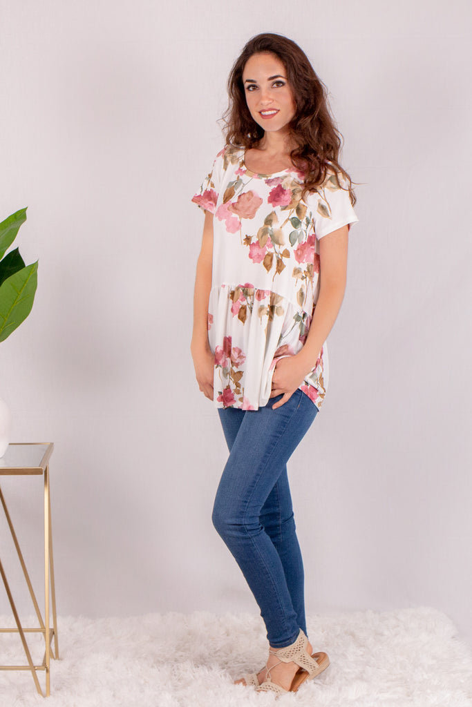 Cream/Floral Short Sleeve Swing Peplum Top with Skinny Jeans Front View 2