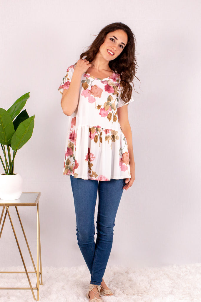 Cream/Floral Short Sleeve Swing Peplum Top with Skinny Jeans Front View 1