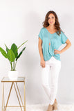 Teal V-Neck Twist Front Top with White Skinny Jeans Front View
