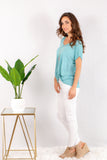 Teal V-Neck Twist Front Top with White Skinny Jeans Side View