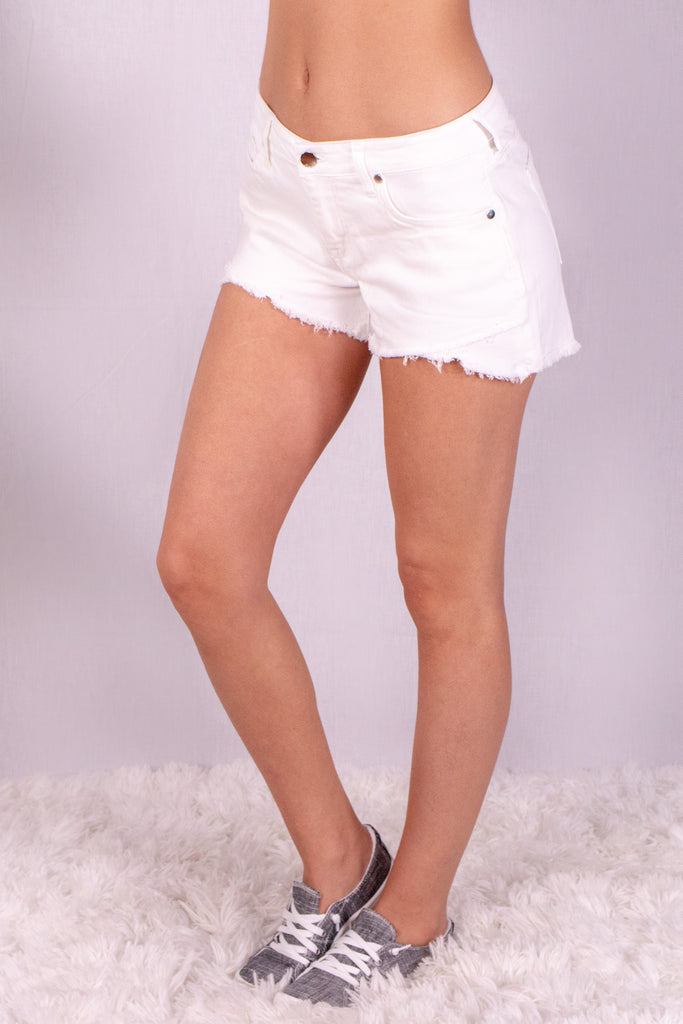 Frayed White Denim Shorts with Overlap Hem Front Left View