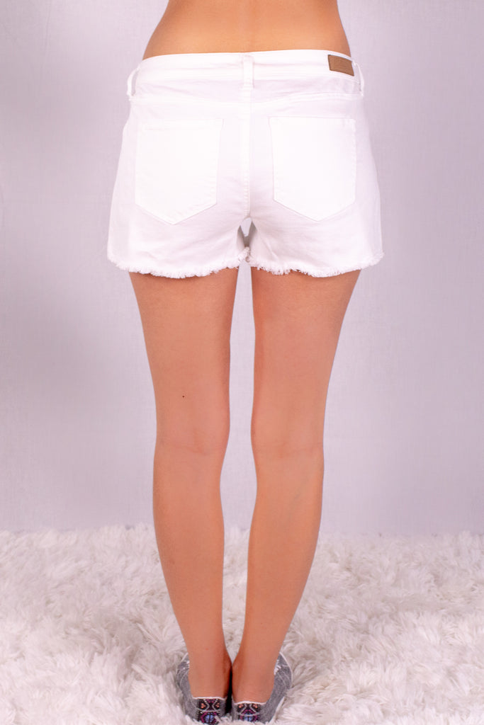 Frayed White Denim Shorts with Overlap Hem Back View