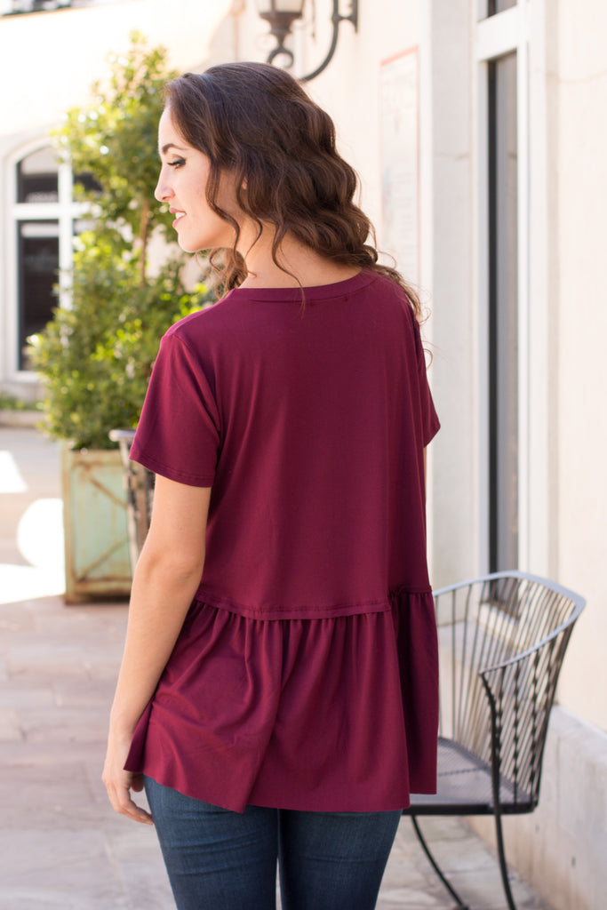 Entro Short Sleeve Peplum Top with Raw Edge Hem (Back Close Up View)