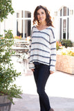 White and Gray/Pink Striped Slouchy Sweater with Slit Hem w/ Jeans Front View