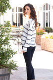 White and Gray/Pink Striped Slouchy Sweater with Slit Hem w/ Jeans Left Side View