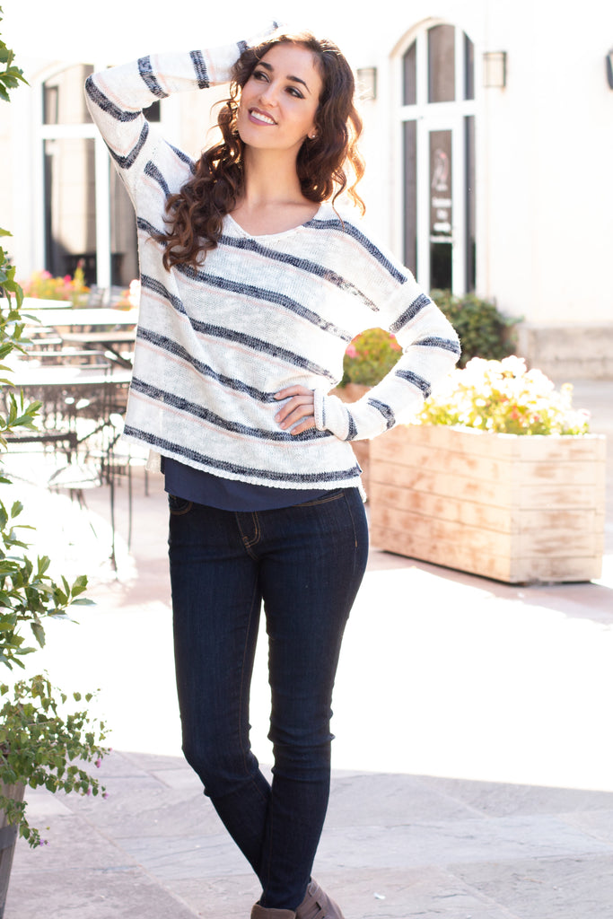 White and Gray/Pink Striped Slouchy Sweater with Slit Hem Front Arms Posed