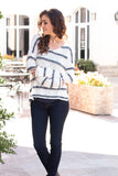 White and Gray/Pink Striped Slouchy Sweater with Slit Hem Front Arms Crossed