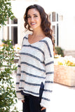 White and Gray/Pink Striped Slouchy Sweater with Slit Hem Left Side Close Up